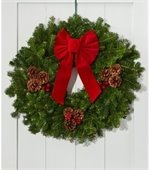 Pine door wreath with red ribbon and pine cone decorations