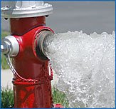 Red Fire Hydrant with water flowing out open port