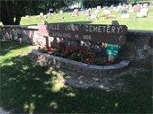 """Saukville Union Cemetery"" sign - flower bed"