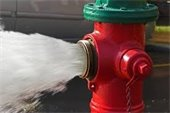 Red Fire Hydrant with water spraying out