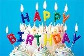 """Happy Birthday"" candles on birthday cake"