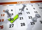 Calendar page w/push pins marking dates