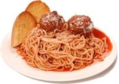 Spaghetti with meatballs and garlic bread on white dinner plate