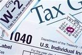 pic with various tax docs - W-2, 1040, April 15 calendar page