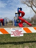 Playground Closed Notice posted at Village parks