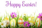 """""""Happy Easter"""" above painted eggs and flowers in the grass"""
