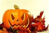 Jack-o-lantern on fall leaves
